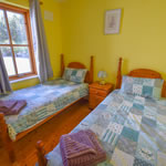 Ground floor twin bedroom at Achill Cottages