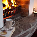 Fireside reading at Achill Cottages