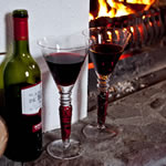Wine and glasses at the open fireside in Achill Cottages