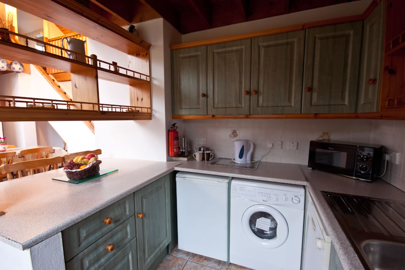 Kitchen Washing Machine ~ Image of kitchen area at achill cottages